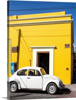 Yellow building and white VW bug, Oaxaca, Mexico