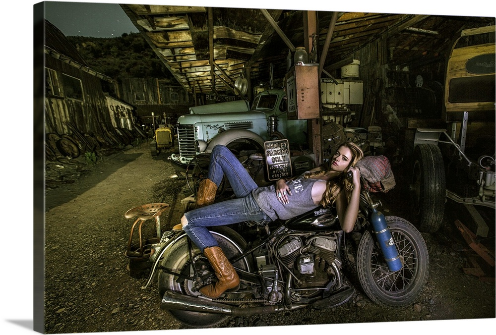 Blonde Girl Laying On An Old Harley Davidson. Canvas