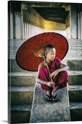 Burmese Monk With Parasol In His Monastery