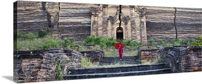 Burmese monk with parasol on Mingun Temple, Burma