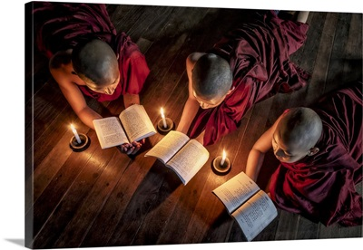 Burmese Monks Reading By Candlelight In Their Monastery