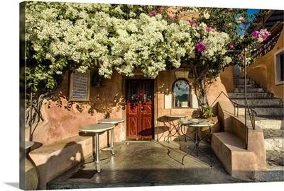 Cafe with bouganvillea in Oia, Santorini, Greece