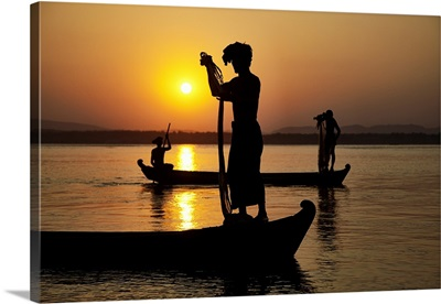Fisherman at sunset with their nets in Mandalay, Burma