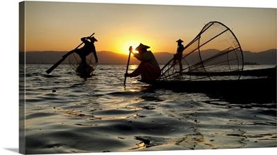 Fisherman on their longtail boats in Inle lake, Burma