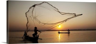 Fisherman with their nets in Mandalay, Burma