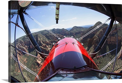 Flying above Sedona, Arizona in a red biplane