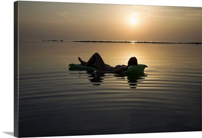 Girl on raft at sunset, Koh Samui, Thailand