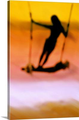 Girl on swing on Koh Samui beach, Thailand