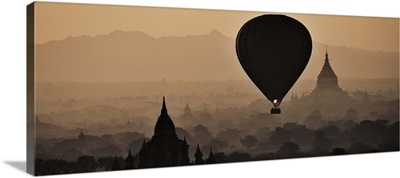Hot air balloons above the temples of Bagan, Myanmar; sunrise