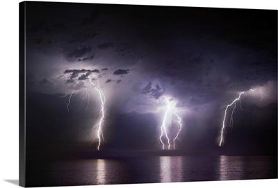Lightning strikes over the ocean