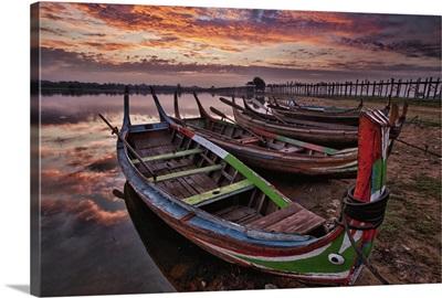 Longtail boats by the Ubein bridge in Mandalay, Burma