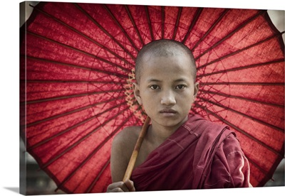 Monk boy with parasol in Pagan, Burma