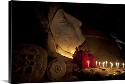 Monk boys praying with reclining Buddha, Bagan, Burma