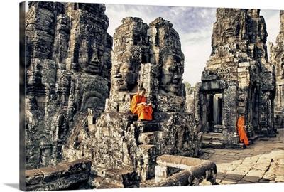 Monk boys reading on the Bayon Temple, Angkor Wat, Cambodia