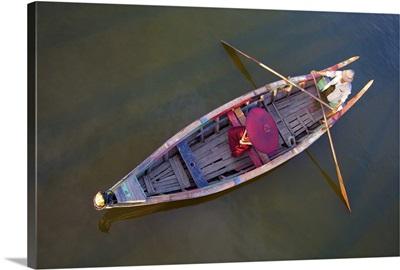 Monk in longtail boat in Mandalay, Burma