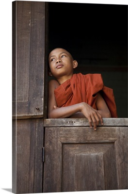 monk in window of his monastery, Mandalay, Burma