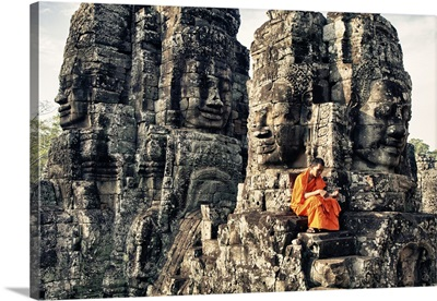 Monk reading atop temple, Angkor Wat, Cambodia