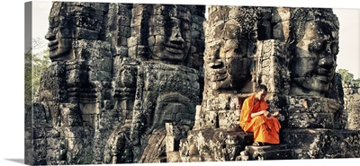 Monk reading in the Bayon of Angkor Wat Temple