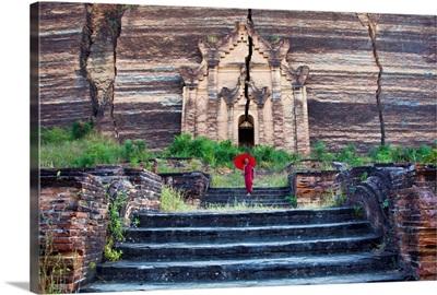 Monk with parasol walking at Mingun Pagoda, Mandalay,Burma