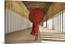 Monk with Parasol walking in Monastery, Bagan, Burma