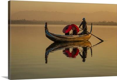 Monks in longtail boat by the Ubein Bridge in Mandalay, Burma