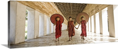 Monks with parasols in Mandalay, Burma