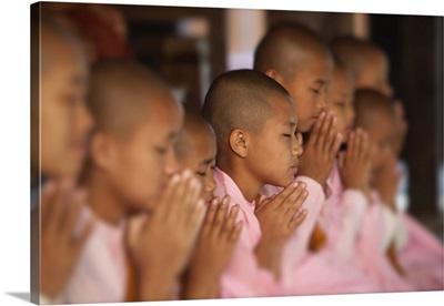 Nuns praying in monastery, Bagan, Burma