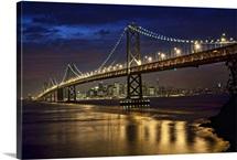 Oakland Bay Bridge and San Francisco skyline at night