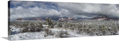 Panorama of the red rocks of Sedona, Arizona covered in snow