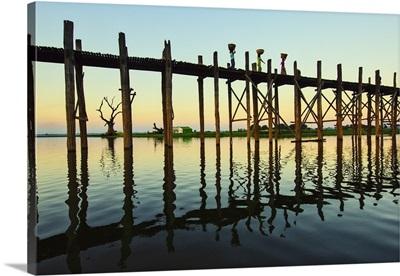 People walking on the Ubein Bridge in Mandalay, Myanmar