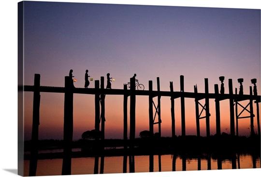 People walking on Ubein Bridge at Sunset, Mandalay, Burma