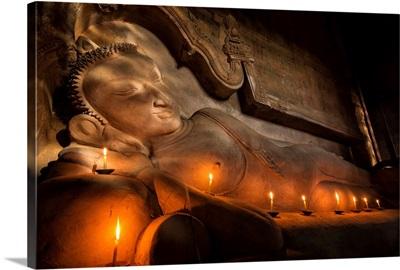 Reclining BUddha with candles in Bagan, Burma
