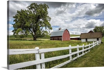 Red barn and white picket fence in the Palouse, Washington