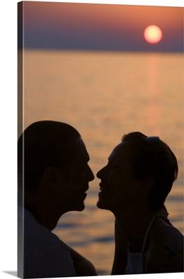 Silhouette of couple by ocean, Little Venice, Mykonos, Greece