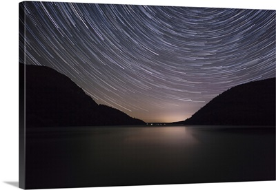 Star trails over Long Pond in Acadia National Park, Maine