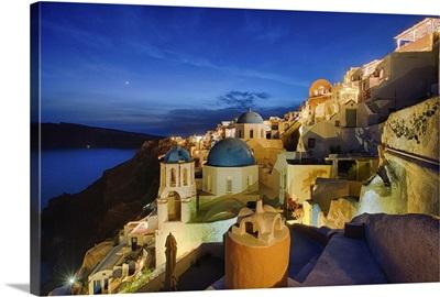 Sunset at Oia, on the island of Santorini, Greece