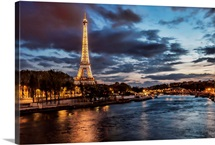 The Eiffel Tower and Seine River at night in Paris