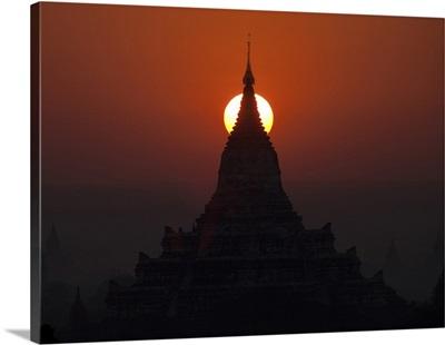 The sun rises behind the temples of Bagan, Myanmar