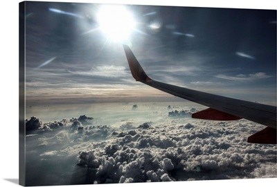 View outside of airplane window, high above the ground