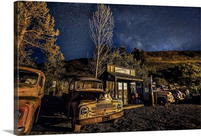 Vintage gas station and old cars after dark in the Palouse, Washington