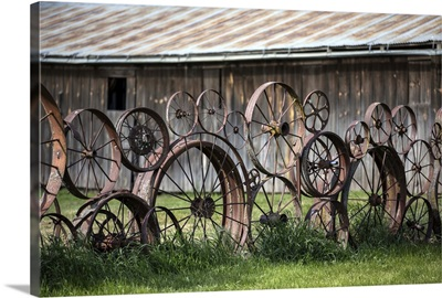 Wagon wheels and barn in the Palouse region of Washington