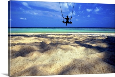 Woman on swing by the ocean, Koh Samui, Thailand