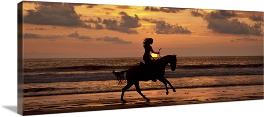 Woman riding a horse on the beach at sunset in costa rica wall art woman riding a horse on the beach at sunset in costa rica publicscrutiny Gallery