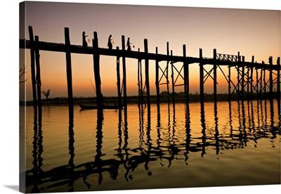 Women with lanterns walking across the Ubein Bridge in Burma