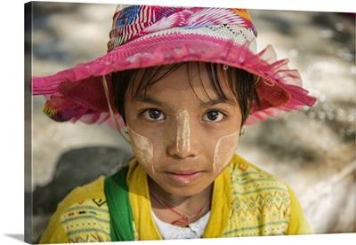 Young Burmese girl with Tanaka face paint