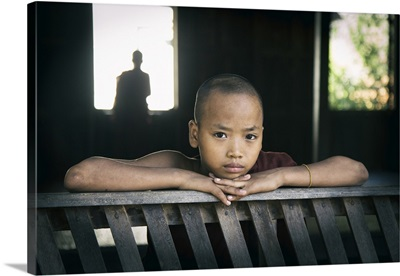 Young Burmese monk in his monastery