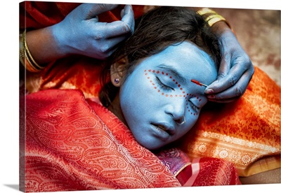 Young Girl Having Her Face Painted In Varinasi, India