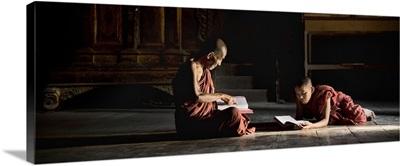 Young monk and monkmaster in their monastery in Burma