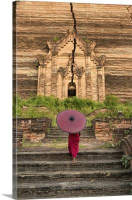 Young monk walking up Mingun Temple in Mandalay, Burma