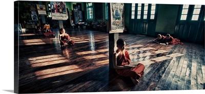 Young monks praying in his monastery, Yangon,Burma